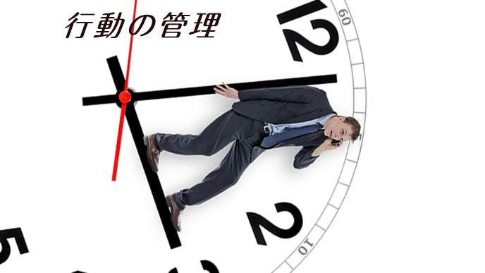 時計の針の上に乗って電話するビジネスマン