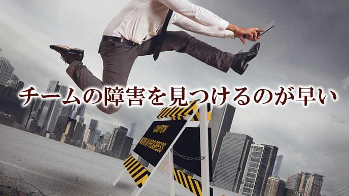 障害物を乗り越えるビジネスマン