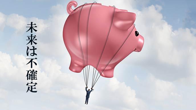 貯金の風船にぶら下がって飛んでいく男性