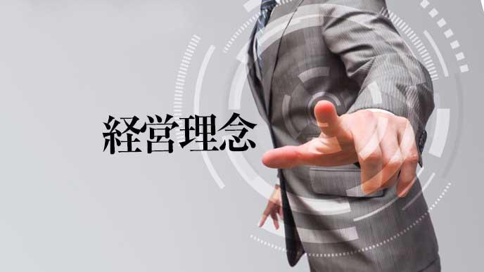 指を指すスーツを着た男性