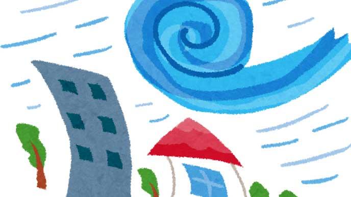 台風の強い風で傾いてる家とビルのイラスト