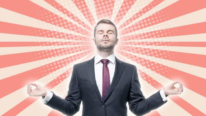 平常心を保とうと瞑想にふけるビジネスマン